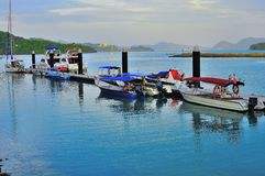Luxury yatch and boats in Langkawi Island. Luxury yatch tied to the jetty of Awana Porto Malai Stock Images