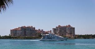 Luxury yatch sails past Fisher Island in Miami, Florida. Luxury yatch sails past Fisher Island in Miami, USA royalty free stock photos