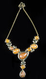 Luxury yellow necklace on black stand Stock Photography