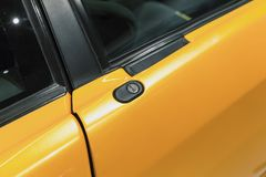 Luxury yellow roadster fragment, door lock. Italian car design Royalty Free Stock Photos