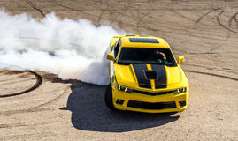 Luxury yellow sport car. Drifting, motion capture stock photos