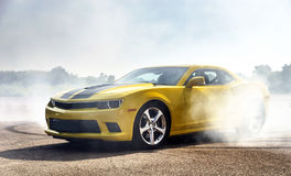Luxury yellow sport car. Drifting, motion capture royalty free stock image