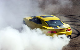 Luxury yellow sport car. Drifting, motion capture Stock Image