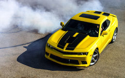 Luxury yellow sport car. Drifting, motion capture royalty free stock images