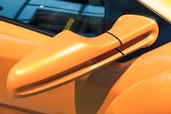 Luxury yellow sports car mirror, close-up. Photo Royalty Free Stock Photo