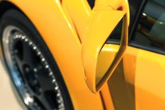Luxury yellow sports car mirror, close up. Photo. Italian car design Royalty Free Stock Images