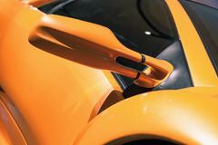Luxury yellow sports car mirror, close up. Photo Royalty Free Stock Photography