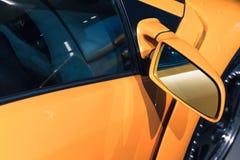 Luxury yellow sports car mirror, closeup. Photo Stock Photos