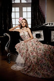 Luxury young smiling beautiful woman in vintage dress in elegant Stock Photos