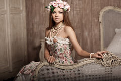 Luxury young smiling beautiful woman in vintage dress in elegant Royalty Free Stock Image