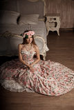 Luxury young smiling beauty woman in vintage dress in elegant in Royalty Free Stock Photo