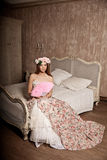 Luxury young smiling beauty woman in vintage dress in elegant in Stock Images