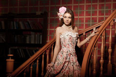 Luxury young smiling beauty woman in vintage dress in elegant in Stock Image