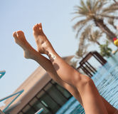 Luxury young woman legs and feet sunbathing Royalty Free Stock Photo
