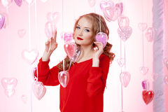 Luxury young woman in red Royalty Free Stock Image