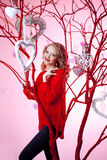Luxury young woman in red Stock Images