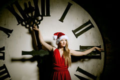 Luxury young woman in Santa costume on the big dial. Girl and cl Stock Images