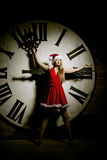 Luxury young woman in Santa costume on the big dial. Girl and cl Stock Image