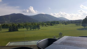 Luxus view. On golf grass and on mountain Royalty Free Stock Photos