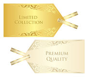 Luxuscreme und goldener Preis mit Weinleseklaps Stockbilder