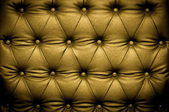 Luxusgoldlederbeschaffenheit mit geknöpftem Muster Stockfotos