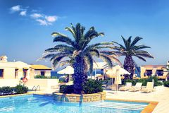 Luxury hotels with crystal clear pool. Crete Island, Hersonissos, Greece royalty free stock photo