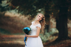 Luxuty portrait of blonde bride with bridal bouquet in autumn Royalty Free Stock Photos