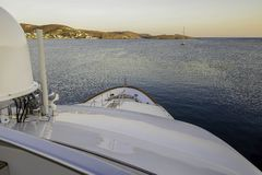 Luxy Yacht cruising towards mainland. Mega private Yacht cruising in the Ionian Sea in Greece stock photography