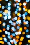 Luz azul, amarela e alaranjada abstrata do bokeh Imagens de Stock
