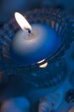 Luz azul de la vela Imagenes de archivo
