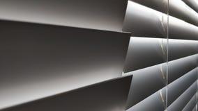 Luz branca através do painel cinzento do obturador fotografia de stock royalty free