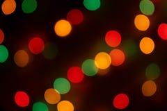 Luz brilhante colorido defocused borrada, pontos brilhantes coloridos, fundo preto foto de stock royalty free