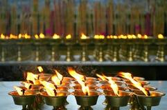 A luz da ghee, pray para a felicidade imagens de stock