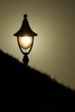 Luz da lâmpada no por do sol Imagens de Stock Royalty Free