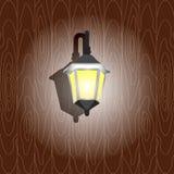 Luz da parede na parede de madeira Imagens de Stock Royalty Free