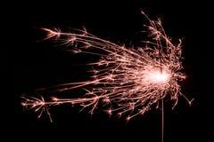 Luz de Bengala anaranjada chispeante de la Navidad/del Año Nuevo Imágenes de archivo libres de regalías
