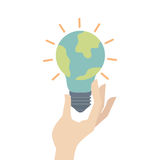 Luz de bulbo com ícone do planeta da terra Imagem de Stock Royalty Free