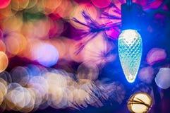 Luz de Chirstmas com o Bokeh no fundo Fotos de Stock