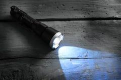 Luz de la antorcha del bolsillo fotos de archivo libres de regalías