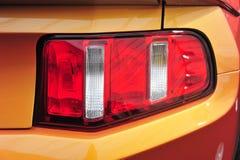 Luz de la cola de un coche del músculo Imágenes de archivo libres de regalías