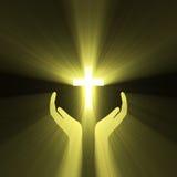 Luz de la cruz de dios del abrazo de la mano Fotos de archivo libres de regalías