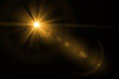 Luz de la llamarada de la lente sobre fondo negro Fácil añadir la capa o s Imágenes de archivo libres de regalías