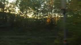 Luz de la puesta del sol del viaje de tren almacen de video