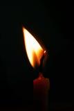 Luz de la vela en fondo negro Imagen de archivo libre de regalías