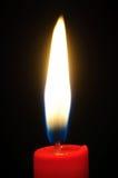 Luz de la vela roja Fotos de archivo libres de regalías