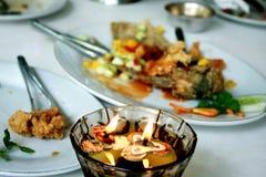 Luz de la vela y buen alimento fotografía de archivo libre de regalías