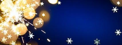 Luz de los días de fiesta de Art Christmas en fondo azul fotografía de archivo libre de regalías