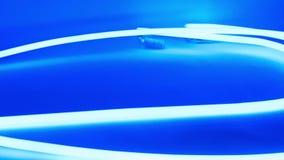 Luz de néon abstrata do azul do fulgor filme