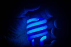 Luz de néon & mão azuis Imagens de Stock Royalty Free