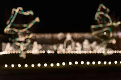 Luz de Natal do fundo do borrão Fotografia de Stock